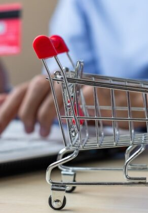 businessman-holding-credit-card-using-laptop-for-online-shopping-while-making-orders-internet_t20_oR99X3